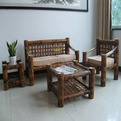 A Set Of Bamboo Desk And Chairs